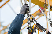 Rope access worker checking equipment