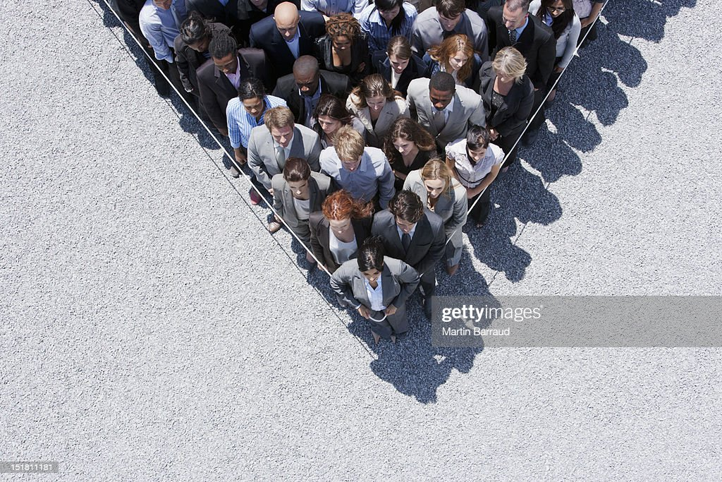 Rope around business people : Stock Photo