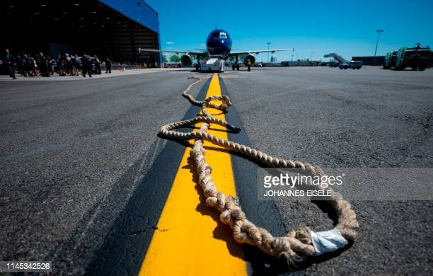 TOPSHOT A rope attached to a JetBlue A320 aircraft is ready for competitors in a Plane Pull at John F Kennedy International Airport on May 21 2019 in...