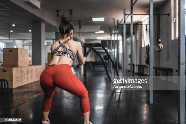 rope cardiovascular training for female athlete in gym - buttock photos stock pictures, royalty-free photos & images