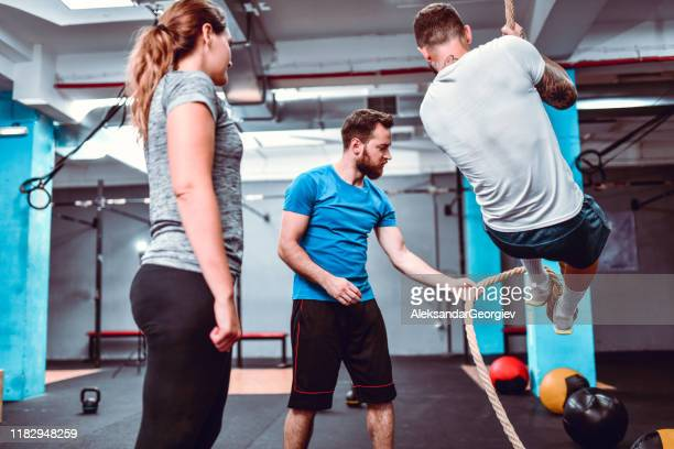 rope climbing exercise lesson - tall high stock pictures, royalty-free photos & images