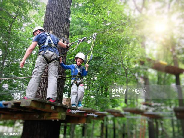 Rope course climbing obstacle adventure teamwork
