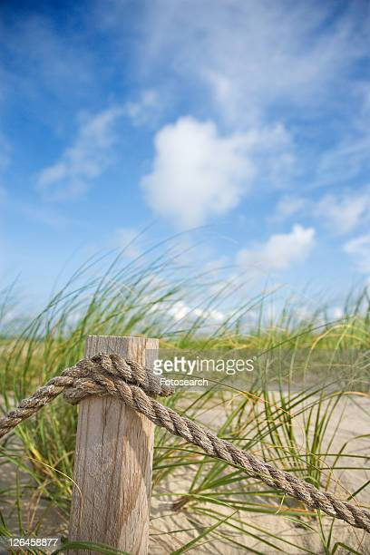 Rope fence barrier on beach.