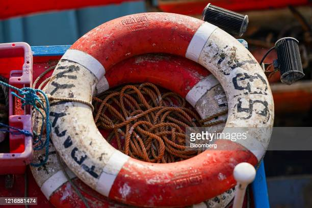 Rope is coiled inside life buoys on a fishing boat in the harbour in Scarborough UK on Tuesday June 2 2020 The threat of a nodeal Brexit is back and...