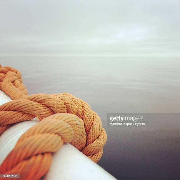 Rope On Boat At Sea Against Sky
