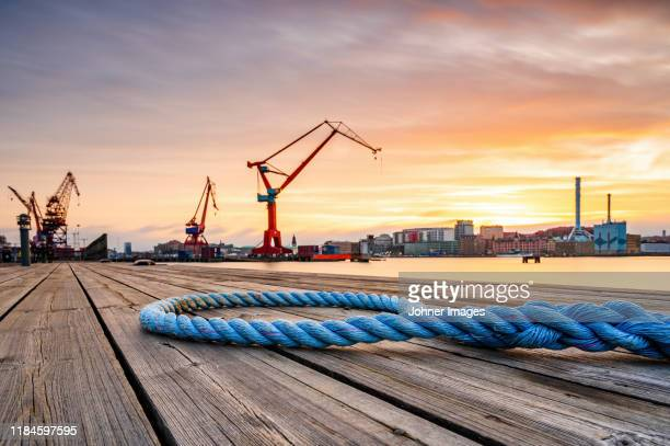 rope on wooden deck, port on background - gothenburg stock pictures, royalty-free photos & images