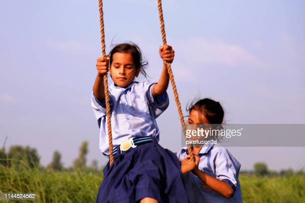 rope swing! - haryana stock pictures, royalty-free photos & images