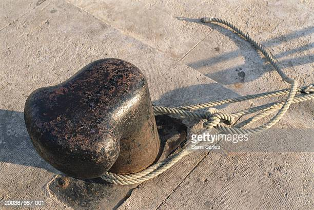 Rope tied around bollard, close-up