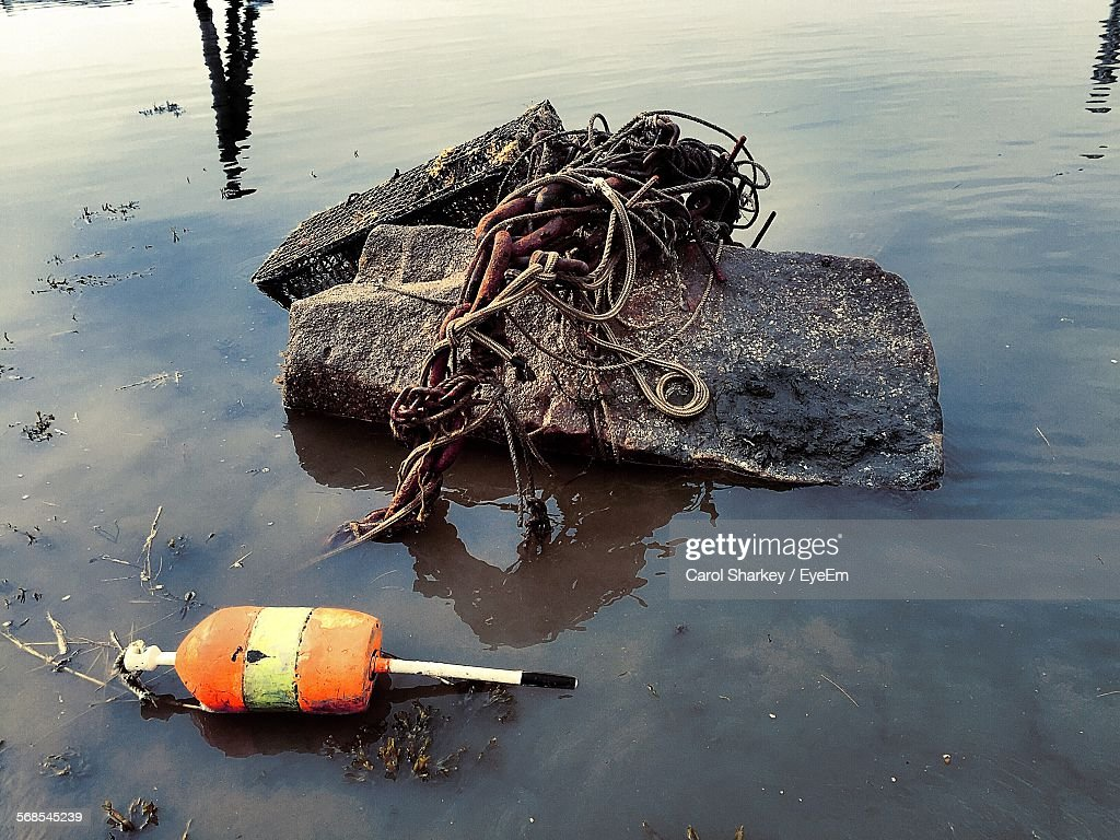 Rope Tied On Buoy And Stone In Water : Stock Photo