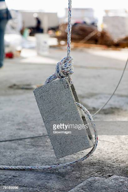 rope tightened on a concrete block - tighten stock photos and pictures