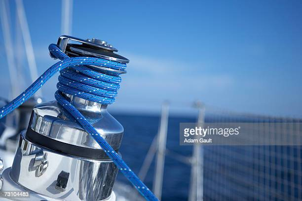 Rope wound around winch on sailboat