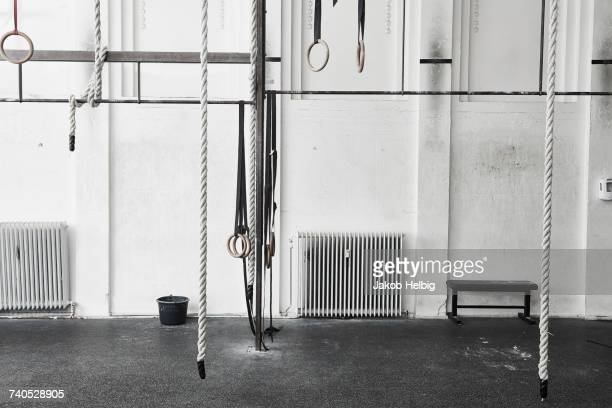 Ropes and gymnastic rings in cross training gym