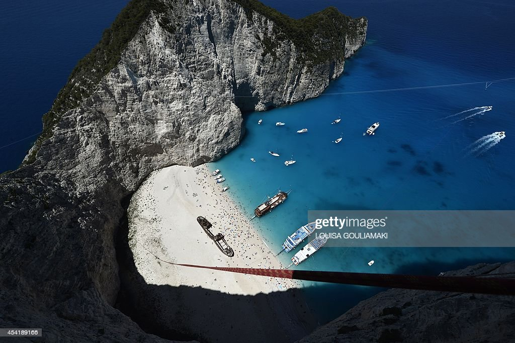 Ropes are attached to jumpers' platform atop the rugged rocks overlooking the azure waters of Navagio beach, one of the Greece's most renowned leisure spots on the popular tourist island of Zakynthos on June 23, 2014. This is rope jumping -- part diving, part rock climbing, with a touch of engineering. The aim of the project is to dream jump in 80 places with most ravishing nature and architecture all over the world .They plan to stage their next leaps at a cave complex in Croatia, a French viaduct, skyscrapers in Las Vegas and Johannesburg, and the Grand Canyon.