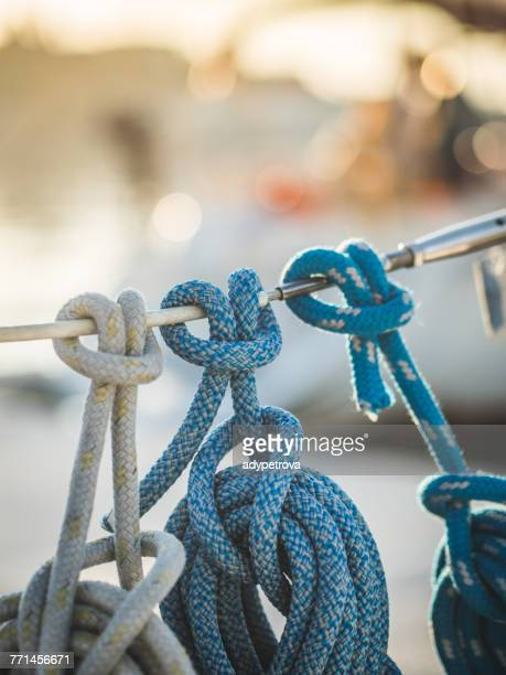 ropes on a sailing boat - tied knot stock photos and pictures