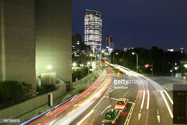 roppongi hills mori tower in tokyo, japan, by night - roppongi hills stock pictures, royalty-free photos & images