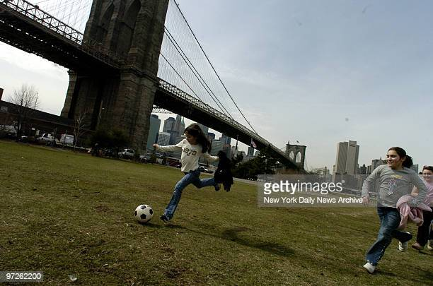 Rops at Empire Fulton Ferry State Park., - Friends off from school for Easter break and enjoying the nice weather, kick around a soccer ball at the...