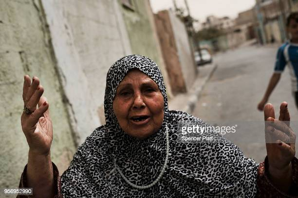 Roqia Hissi age 75 pauses in the street to denounce the living conditions in Gaza on May 10 2018 in Gaza City Gaza Tensions are high along the...