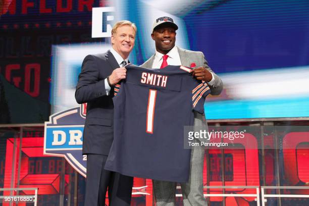 Roquan Smith of Georgia poses with NFL Commissioner Roger Goodell after being picked overall by the Chicago Bears during the first round of the 2018...