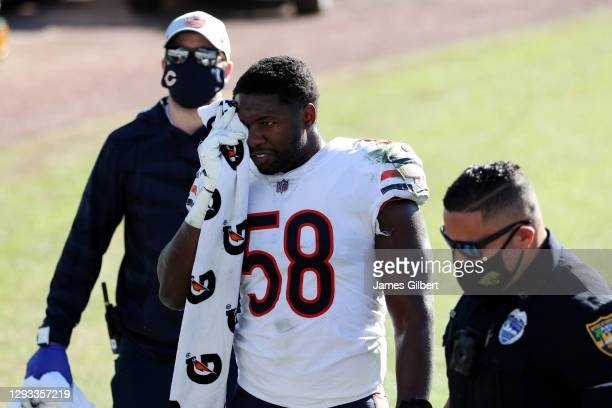 Roquan Smith of the Chicago Bears exits the field after an injury during the second half against the Jacksonville Jaguars at TIAA Bank Field on...