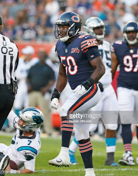 Roquan Smith of the Chicago Bears reacts after sacking Kyle Allen of the Carolina Panthers during the first quarter of a preseason game at Soldier...