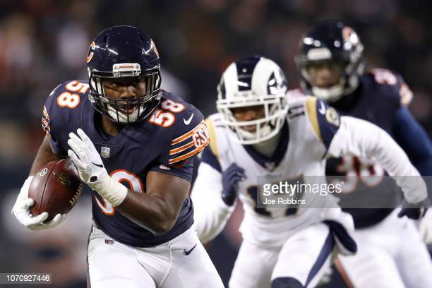 Roquan Smith of the Chicago Bears returns an interception in the second quarter against the Los Angeles Rams at Soldier Field on December 9, 2018 in...