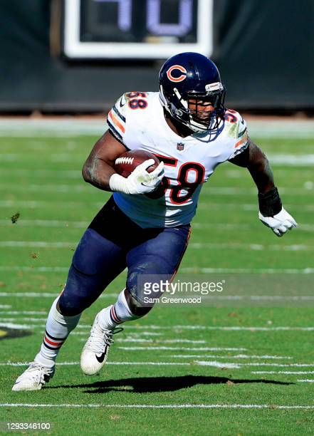Roquan Smith of the Chicago Bears runs for yardage after making an interception against the Jacksonville Jaguars at TIAA Bank Field on December 27,...