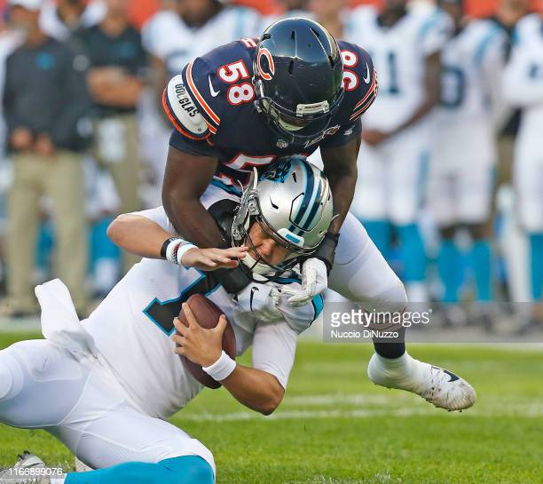 Roquan Smith of the Chicago Bears sacks Kyle Allen of the Carolina Panthers during the first quarter of a preseason game at Soldier Field on August...