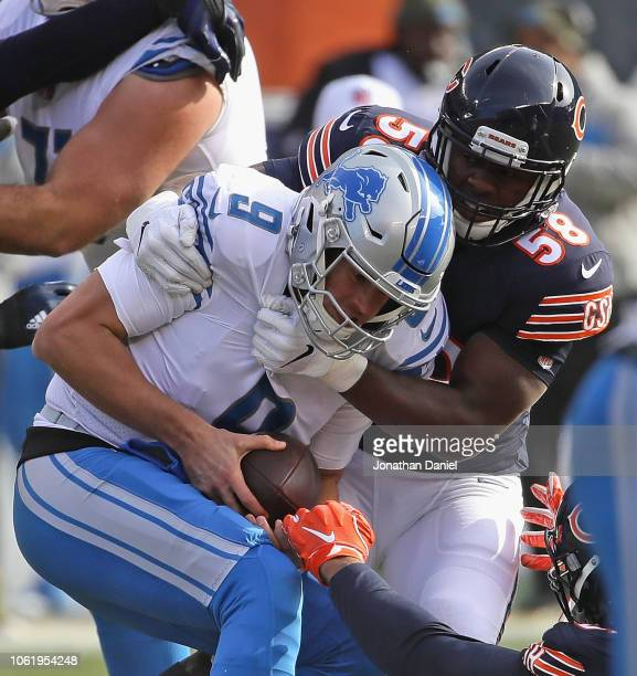 Roquan Smith of the Chicago Bears sacks Matthew Stafford of the Detroit Lions at Soldier Field on November 11, 2018 in Chicago, Illinois. The Bears...