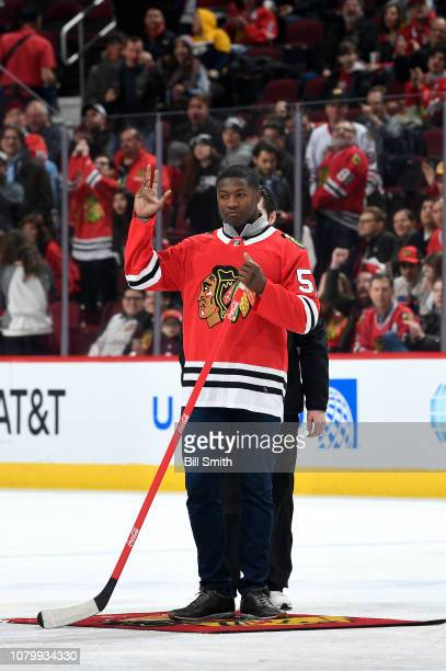Roquan Smith of the Chicago Bears shoots the puck in between periods of the game between the Chicago Blackhawks and the Nashville Predators at the...