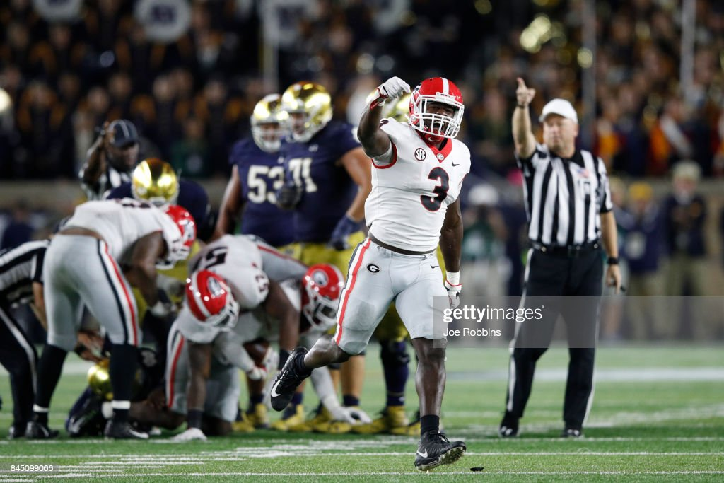 Roquan Smith #3 of the Georgia Bulldogs celebrates after a fumble recovery by a teammate in the fourth quarter of a game against the Notre Dame Fighting Irish at Notre Dame Stadium on September 9, 2017 in South Bend, Indiana. Georgia won 20-19.