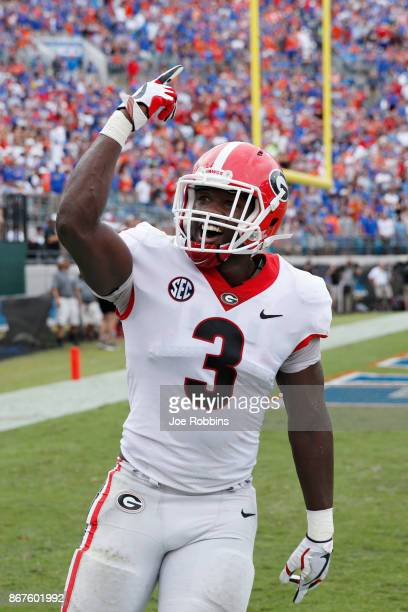 Roquan Smith of the Georgia Bulldogs celebrates after a goal line stand in the second quarter of a game against the Florida Gators at EverBank Field...