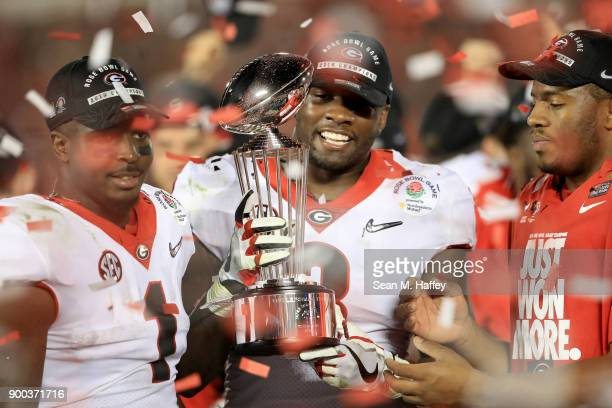 Roquan Smith of the Georgia Bulldogs celebrates after defeating the Oklahoma Sooners 5448 in double overtime in the 2018 College Football Playoff...