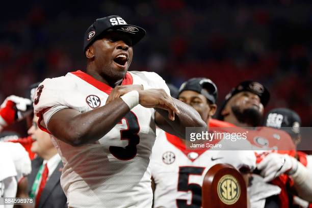 Roquan Smith of the Georgia Bulldogs reacts to winning the game MVP trophy after beating the Auburn Tigers in the SEC Championship at MercedesBenz...