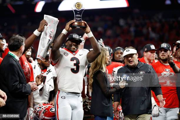 Roquan Smith of the Georgia Bulldogs reacts to winning the game MVP trophy after beating the Auburn Tigers in the SEC Championship at Mercedes-Benz...