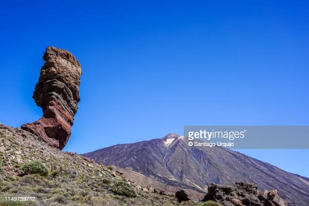 roque de garcia with teide volcano on background - el teide national park stock pictures, royalty-free photos & images