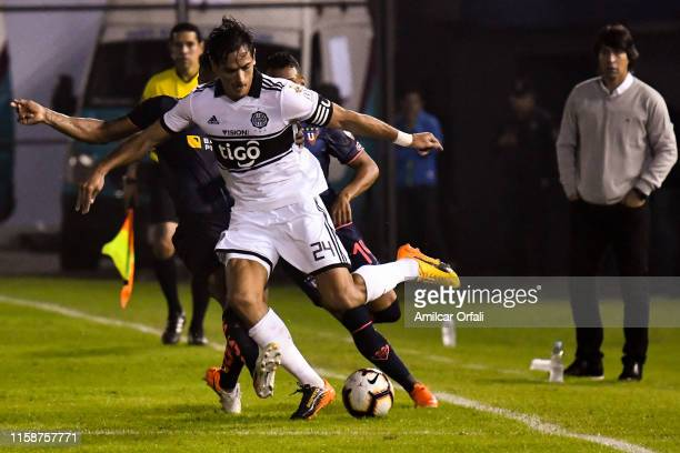 Roque Luis Santa Cruz Cantero of Olimpia fight for the ball with Cristian Martinez Borja of Liga Franklin Guerra of Liga during a round of sixteen...