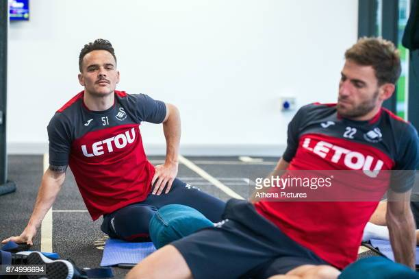 Roque Mesa and Angel Rangel exercise in the gym during the Swansea City training session at The Fairwood training Ground on November 16 2017 in...