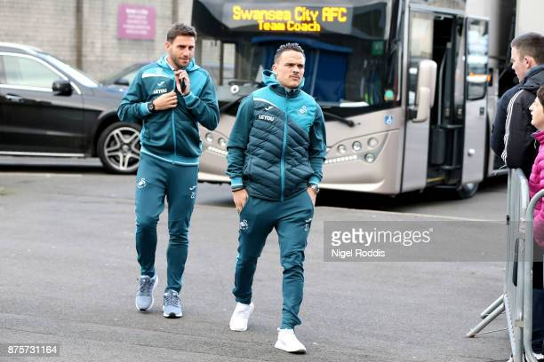 Roque Mesa and Angel Rangel of Swansea City arrive prior to the Premier League match between Burnley and Swansea City at Turf Moor on November 18...