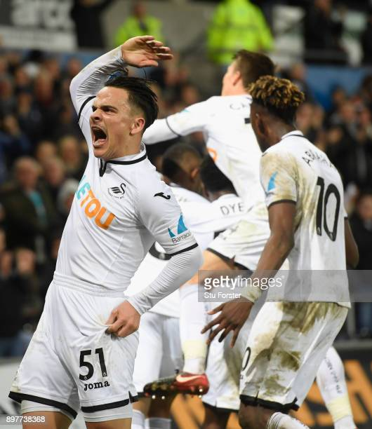 Roque Mesa celebrates the Swansea goal with team mates during the Premier League match between Swansea City and Crystal Palace at Liberty Stadium on...