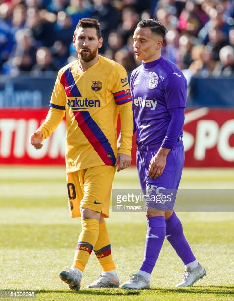 Roque Mesa of CD Leganes and Lionel Messi of FC Barcelona look on during the Liga match between CD Leganes and FC Barcelona at Estadio Municipal de...