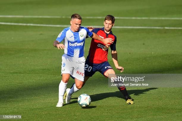 Roque Mesa of Leganes battles for possession with Darko Brasanac of Osasuna during the Liga match between CA Osasuna and CD Leganes at Estadio El...