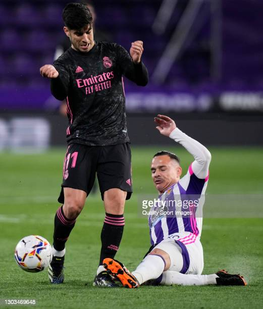 Roque Mesa of Real Valladolid battle for the ball with Marco Asensio of Real Madrid during the La Liga Santander match between Real Valladolid CF and...