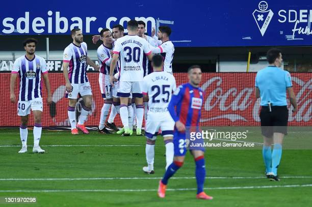 Roque Mesa of Real Valladolid celebrates with team mates after scoring their side's first goal during the La Liga Santander match between SD Eibar...