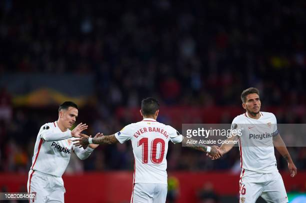 Roque Mesa of Sevilla FC and Daniel Carrico of Sevilla FC shake hans with Ever Banega of Sevilla FC during the UEFA Europa League Group J match...