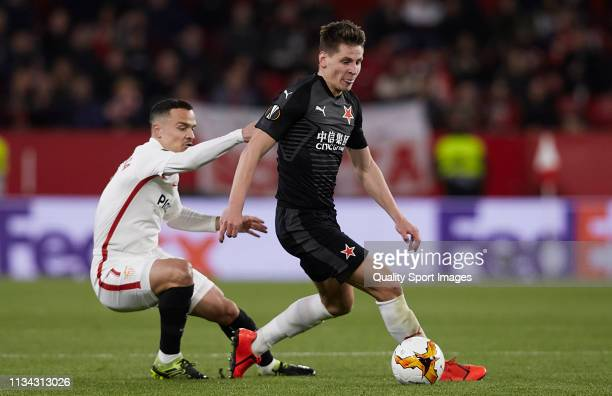 Roque Mesa of Sevilla FC competes for the ball with Lukas Masopust of Slavia Prague during the UEFA Europa League Round of 16 First Leg match between...