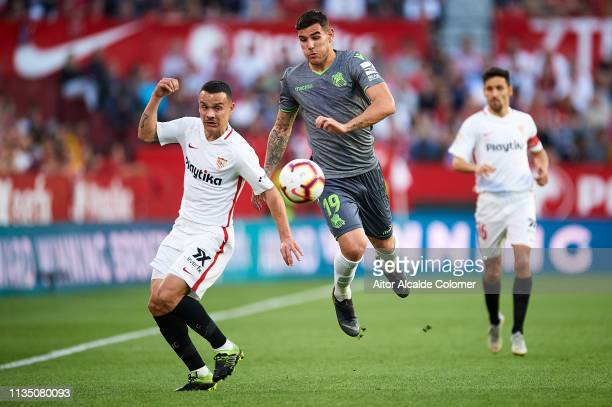 Roque Mesa of Sevilla FC competes for the ball with Theo Hernandez of Real Sociedad during the La Liga match between Sevilla FC and Real Sociedad at...