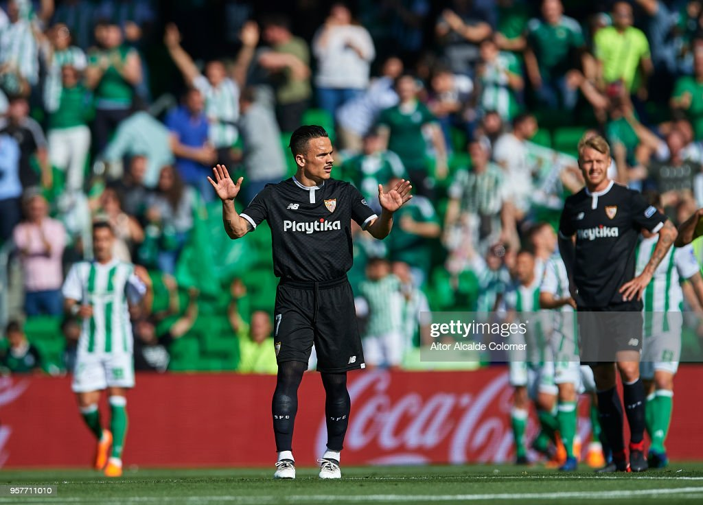 Roque Mesa of Sevilla FC reacts after Real Betis Balompie scores a goal during the La Liga match between Real Betis and Sevilla at Estadio Benito Villamarin on May 12, 2018 in Seville, .