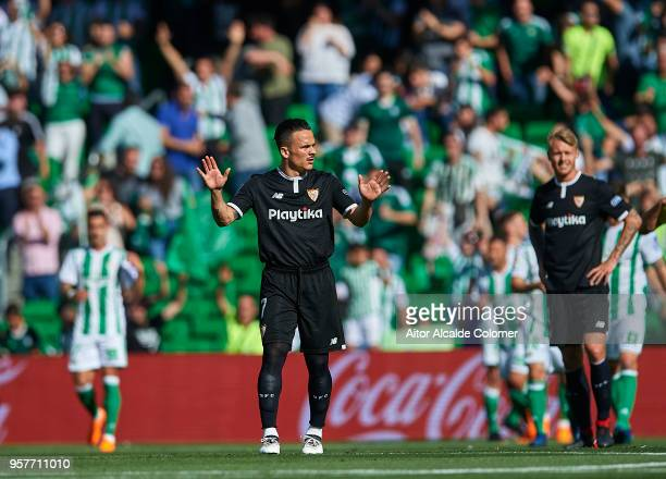Roque Mesa of Sevilla FC reacts after Real Betis Balompie scores a goal during the La Liga match between Real Betis and Sevilla at Estadio Benito...