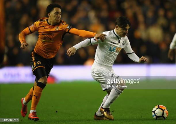 Roque Mesa of Swansea challenged by Helder Costa of Wolves during the Emirates FA Cup Third Round match between Wolverhampton Wanderers and Swansea...
