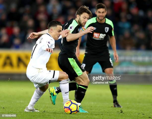 Roque Mesa of Swansea City and Harry Arter of AFC Bournemouth battles for possesion with during the Premier League match between Swansea City and AFC...
